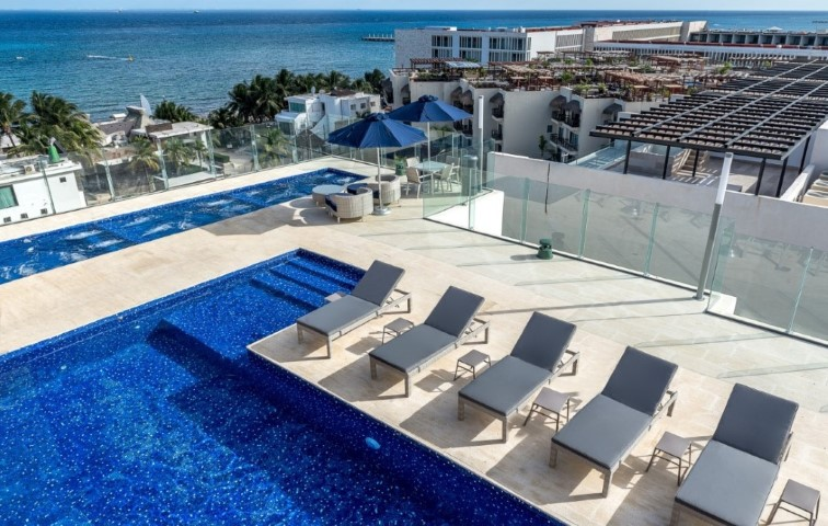 Condo for sale in CRUZ CON MAR community in Playa del Carmen